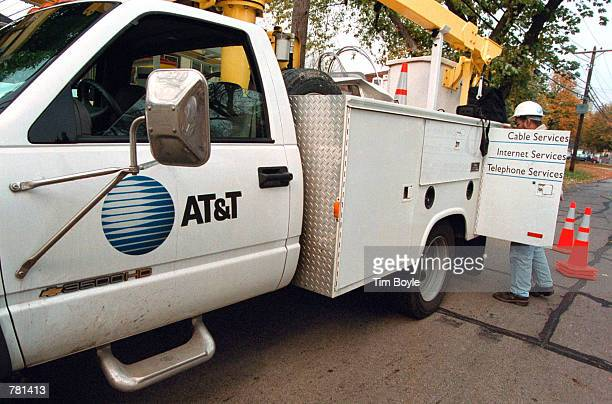 An AT&T advance-line technician parks his service truck October 26, 2000 as he prepares to troubleshoot an aerial cable in Des Plaines, Illinois. On...