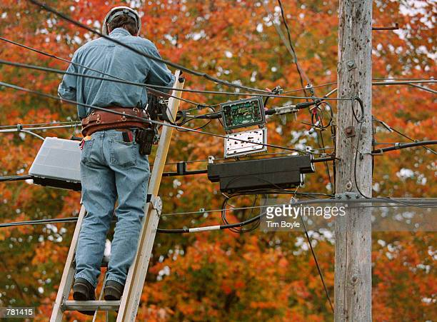 An ATT advanceline technician troubleshoots an aerial cable October 26 2000 in Des Plaines Illinois On October 25 ATT Corp announced that it was...
