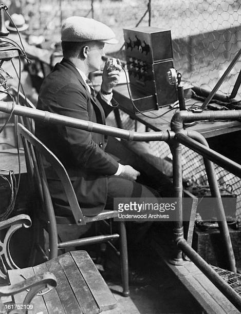 An AT&T engineer tests out his company's equipment for broadcasting the third game of the 1924 World Series at the Polo Grounds in New York, New...