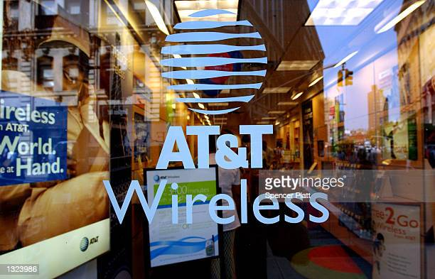 An AT&T sign greet customers at an AT&T Wireless store July 9, 2001 in New York City. The cable company Comcast has made a bid to merge with AT&T...