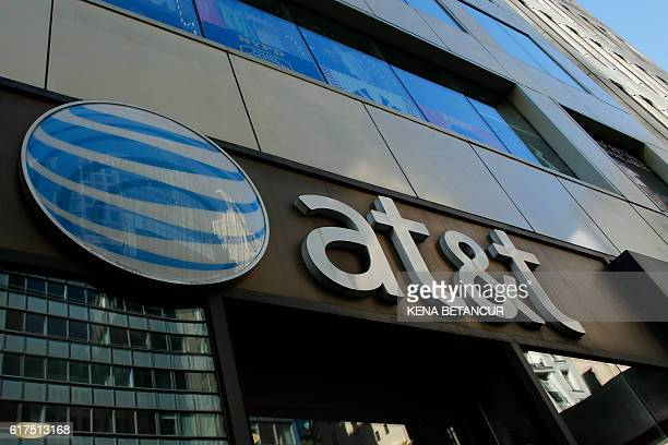 An AT&T store is seen on 5th Avenue in New York on October 23, 2016. AT&T unveiled a mega-deal for Time Warner that would transform the telecom giant...