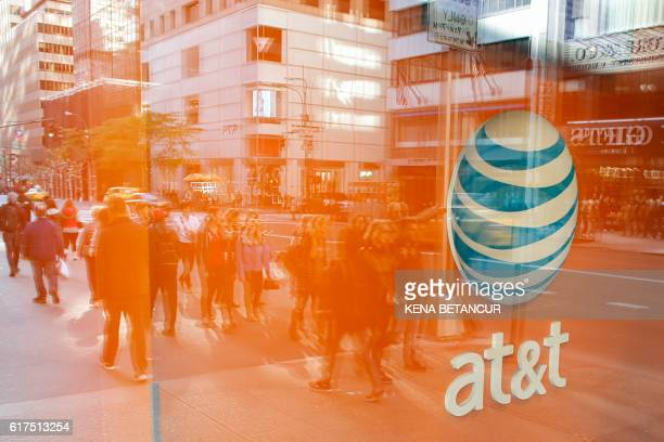 An AT&T store is seen on 5th Avenue in New York on October 23, 2016. - AT&T unveiled a mega-deal for Time Warner that would transform the telecom...