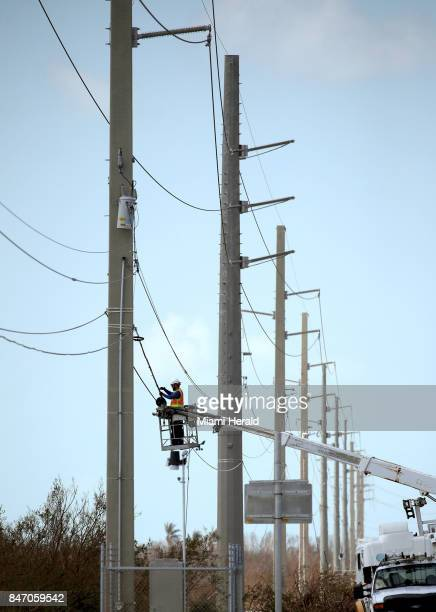 An ATT worker repairs lines along the Overseas Highway in the Florida Keys on Wednesday Sept 13 2017