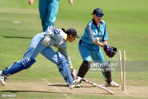 An attempted run out by England's wicket keeper Jane Cassar on India's Chopra Anjum
