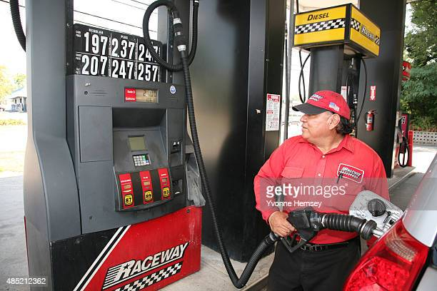 An attendant at a Raceway Petroleum station pumps gas on August 25, 2015 in Woodbridge, New Jersey. Some places in New Jersey are seeing prices under...
