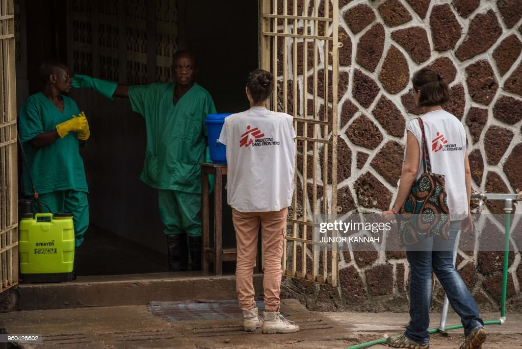 An Attendant Charged To Handle The Access Ebola Security Zone Talks Doctors Without
