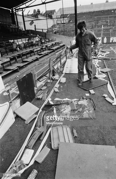 """An attendant cleaning up Luton Town's Kenilworth Road ground the day after the """"Luton Riot"""", which happened during Luton Town vs Millwall FA Cup..."""