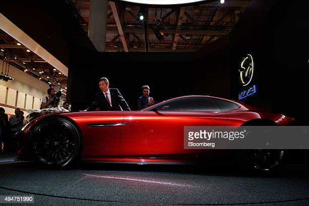 An attendant cleans the Mazda Motor Corp RXVision concept vehicle on display at the Tokyo Motor Show in Tokyo Japan on Wednesday Oct 28 2015 Toyota...