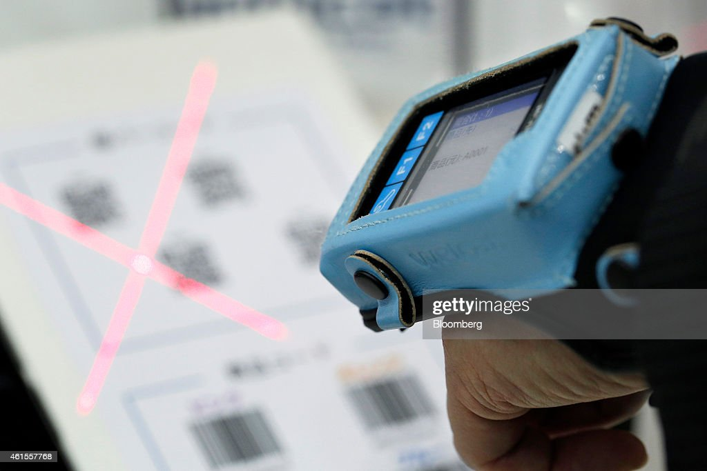 An attendant demonstrates a Welcat inc. wearable bar-code reader at the Wearable Expo in Tokyo, Japan, on Thursday, Jan. 15, 2015. The world largest expo for wearable devices and technologies will be held through Jan. 16. Photographer: Kiyoshi Ota/Bloomberg via Getty Images