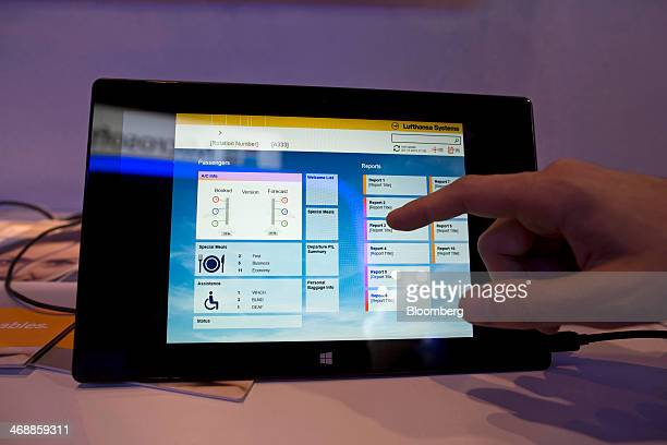 An attendant demonstrates the use of the BoardConnect application developed by Lufthansa Systems Group GmbH and Microsoft Corp shown on a Microsoft...