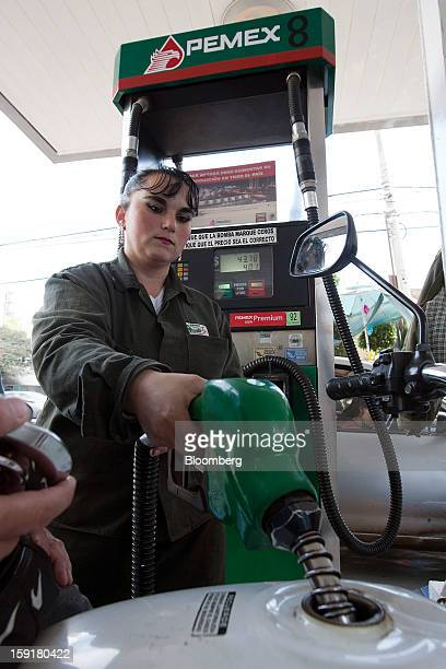 An attendant fills the tank of a motorcycle with gasoline at a Pemex station in Mexico City Mexico on Tuesday Jan 8 2013 Mexico's government is...