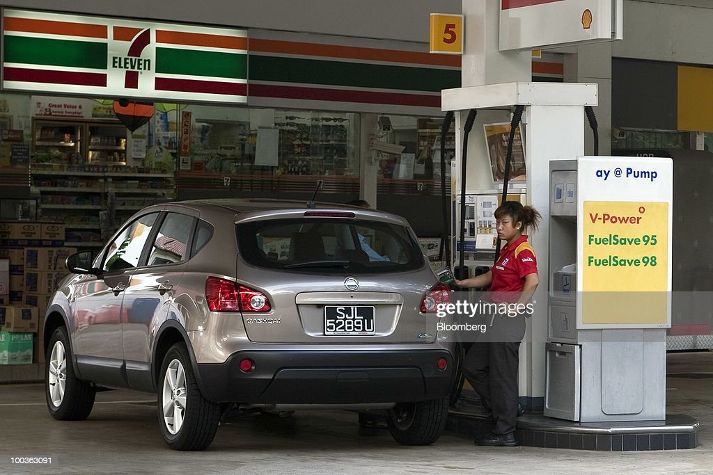 An attendant fills up a customer's car at a Royal Dutch Shell Plc gas station in Singapore, on Monday, May 24, 2010. Singapore's consumer prices rose at the fastest pace in 14 months in April as an accelerating economy and a booming labor market boosted housing and transportation costs. Photographer: Charles Pertwee/Bloomberg via Getty Images