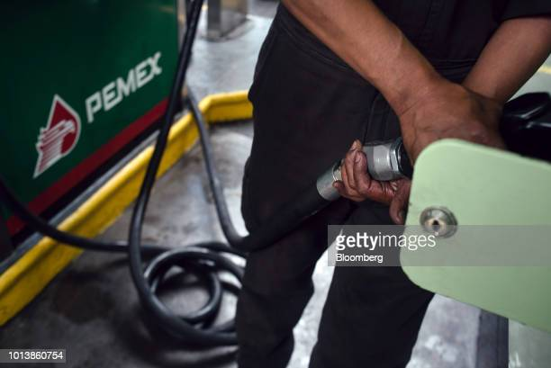 An attendant fuels a bus at a Petroleos Mexicanos gas station in Mexico City Mexico on Monday Aug 6 2018 Mexico's incoming president named a new...