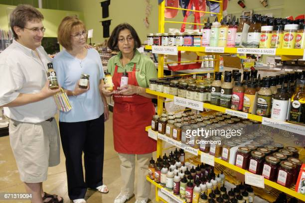 An attendant helping a couple at Molly Bea's Ingredients shop.