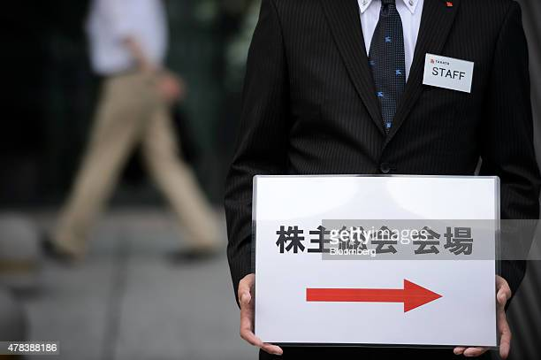 An attendant holds a sign for the Takata Corp annual general meeting in Tokyo Japan on Thursday June 25 2015 Fiat Chrysler Automobiles NV is...
