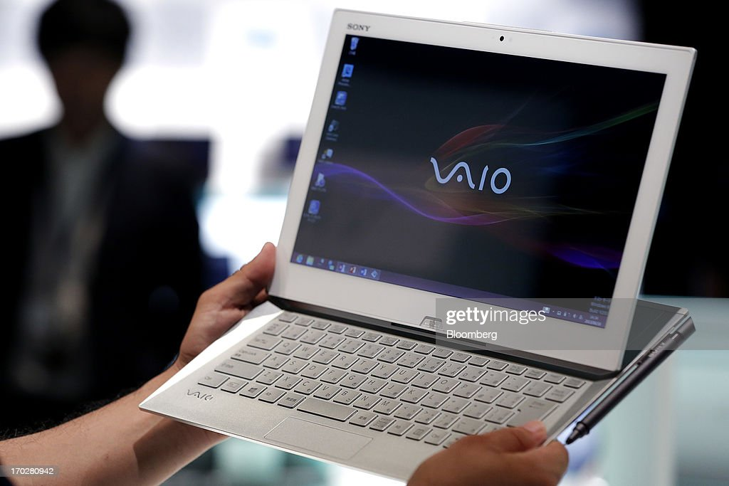 An attendant holds a Sony Corp. Vaio Duo Ultrabook laptop computer for a photograph during a product launch in Tokyo, Japan, on Monday, June 10, 2013. Sony Corp. is Japan's biggest consumer-electronics exporter. Photographer: Kiyoshi Ota/Bloomberg via Getty Images