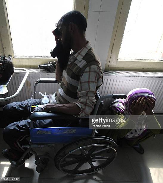 An attendant of injured civilian breaks down in a hospital in Srinagar the summer capital of Indian controlled Kashmir Hundreds of civilians...
