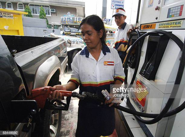 An attendant pumps biodiesel into a passenger van in the Philippine capital Manila 22 August 2005 The Philippines has introduced bio fuels or...