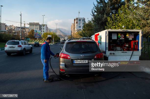 An attendant refuels a vehicle from a Pido mobile gas truck in Tehran Iran on Saturday Nov 3 2018 Irans Supreme Leader Ayatollah Khamenei said US...