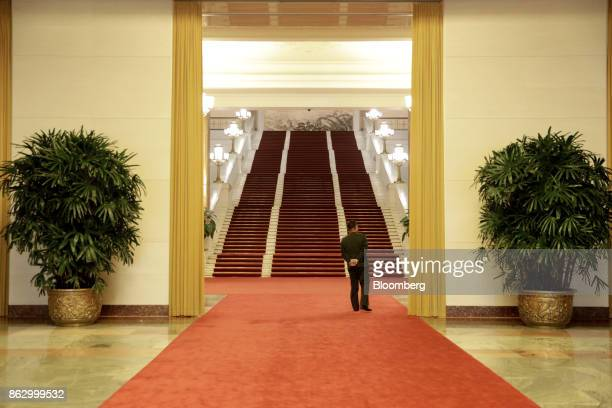 An attendant stands in a hallway in the Great Hall of the People during the 19th National Congress of the Communist Party of China in Beijing, China,...