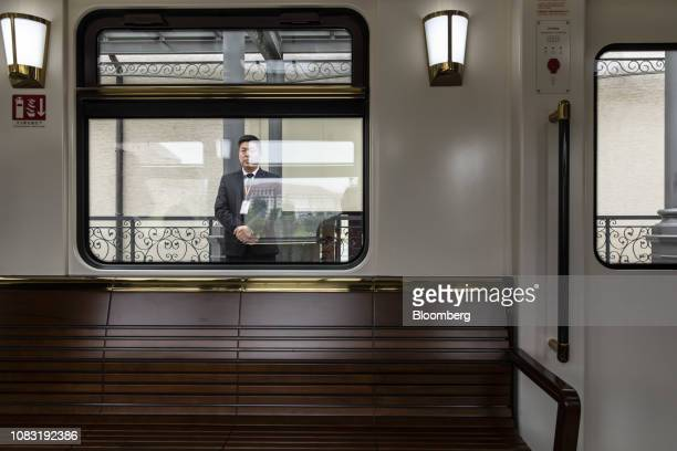 An attendant stands next to a shuttle train on a platform at the Huawei Technologies Co campus in Dongguan China on Tuesday Jan 15 2019 Ren Zhengfei...
