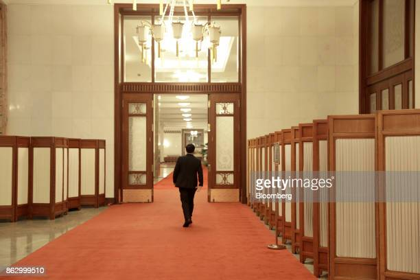 An attendant walks through a hallway in the Great Hall of the People during the 19th National Congress of the Communist Party of China in Beijing,...