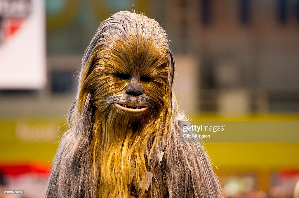 An attendee at Comic Con 2016 in cosplay as Chewbacca from Star Wars on March 19, 2016 in Birmingham, United Kingdom.