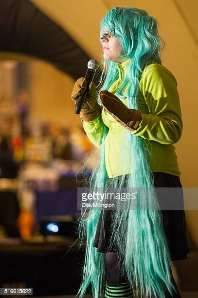 An attendee at Comic Con 2016 in cosplay as Hatsune Miku from Vocaloid competing in the MCM Masquerade at the NEC Birmingham United Kingdom on March...