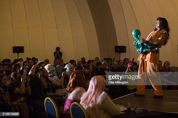 An attendee at Comic Con 2016 in cosplay as Yamcha from Dragon Ball Z fcompeting in the MCM Masquerade at the NEC Birmingham United Kingdom on March...