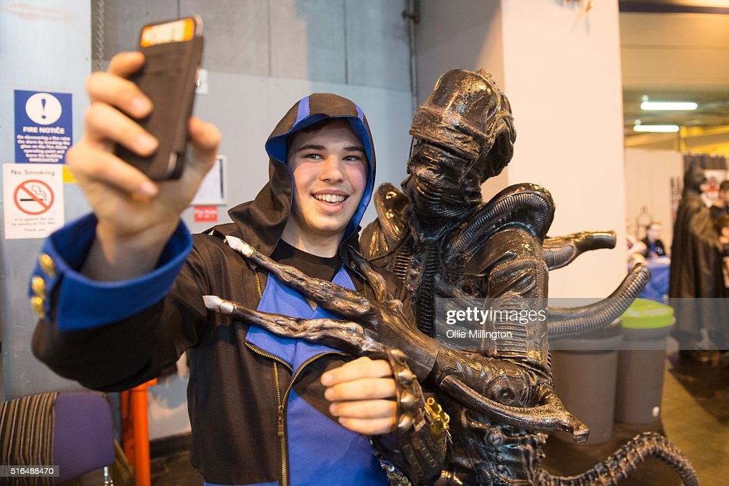 An attendee at Comic Con 2016 in cosplay takes a photograph with a Xenomorph Alien on March 19, 2016 in Birmingham, United Kingdom.