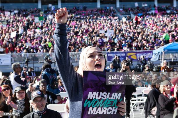 An attendee cheers during the Women's March OneYear Anniversary Power To The Polls event in Las Vegas Nevada US on Sunday Jan 21 2018 On the...