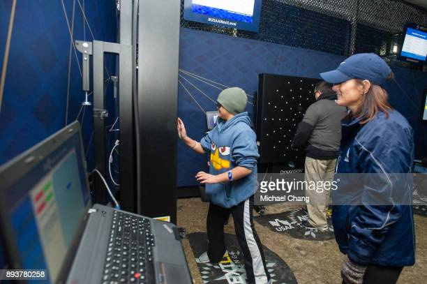 An attendee competes in the USAA Next Level Challenge during Base*FEST Powered by USAA on December 15 2017 at Naval Air Station Pensacola Florida