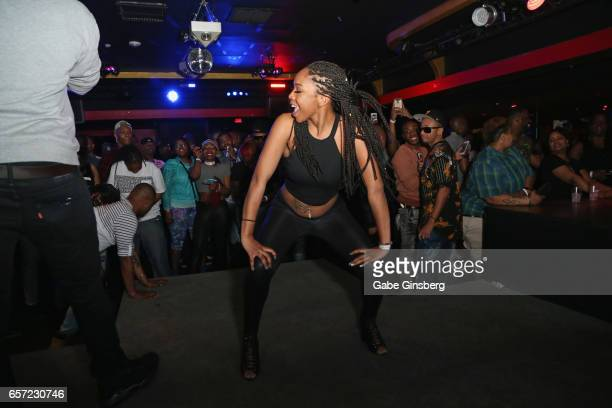 An attendee dances on stage during the 10th annual Tempted2Touch Black LGBT Pride Spring Break Getaway at Flair Nightclub on March 24 2017 in Las...
