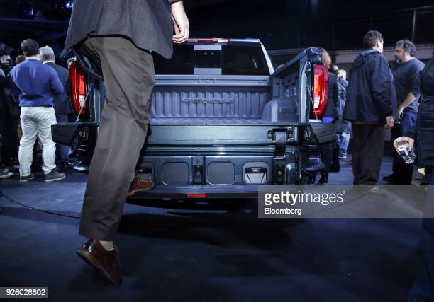 An attendee demonstrate the MultiPro Tailgate of the General Motors Co 2019 GMC Sierra Denali truck during an event at Russell Industrial Complex in...