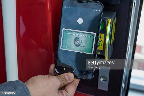 An attendee demonstrates Google Inc Android Pay for a photograph during the Google I/O Annual Developers Conference in San Francisco California US on...