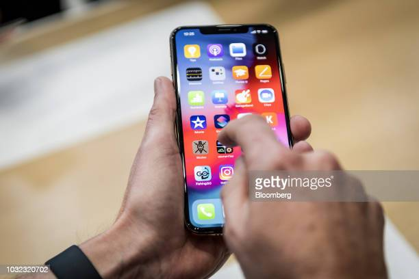 An attendee demonstrates the Apple Inc iPhone XR smartphone during an event at the Steve Jobs Theater in Cupertino California US on Wednesday Sept 12...