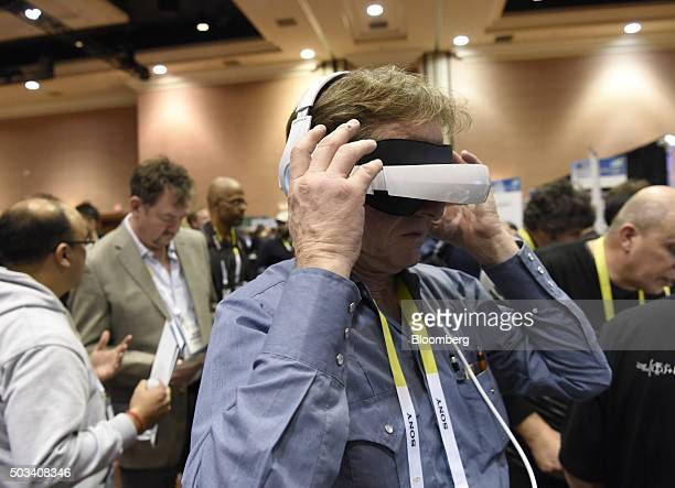 An attendee demonstrates the RoyoleX Foldable Smart Mobile Theatre during CES Unveiled at the 2016 Consumer Electronics Show in Las Vegas Nevada US...