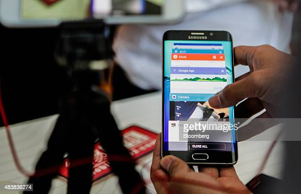 An attendee demonstrates the Samsung Electronics Co Galaxy S6 Edge Plus smartphone during the Samsung Unpacked 2015 event in New York US on Thursday...
