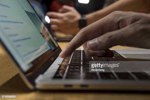 An attendee demonstrates the Touch Bar on a new MacBook Pro laptop computer during an event at Apple Inc headquarters in Cupertino California US on...