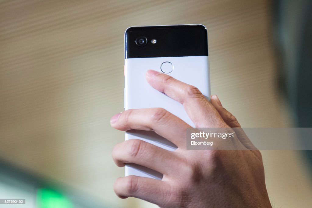 An attendee displays a Google Inc. Pixel 2 XL smartphone during a product launch event in San Francisco, California, U.S., on Wednesday, Oct. 4, 2017. Google unveiled the second generation of its own devices along with an array of entirely new gadgets, plowing the company deeper into a competitive consumer hardware market. Photographer: David Paul Morris/Bloomberg via Getty Images
