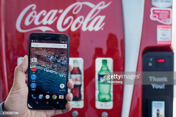 An attendee displays Google Inc Android Pay on a mobile device for a photograph during the Google I/O Annual Developers Conference in San Francisco...