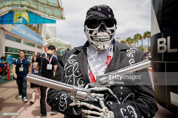 An attendee dressed as Activision Blizzard Inc's Call of Duty character Death Mariachi stands for a photograph during the ComicCon International...