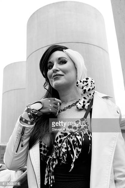 An attendee dressed as Cruella de Vil poses on the first day of 2016 New York Comic Con on October 6 2016 in New York City
