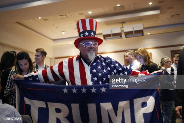 An attendee dressed as Uncle Sam holds a flag in support of US President Donald Trump during an election night rally for Senatorelect Mike Braun a...