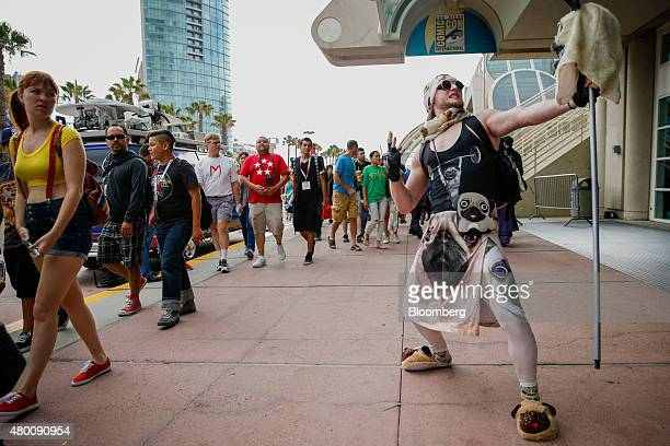 An attendee dressed in a costume featuring Pug dogs stands for a photograph during the ComicCon International convention in San Diego California US...