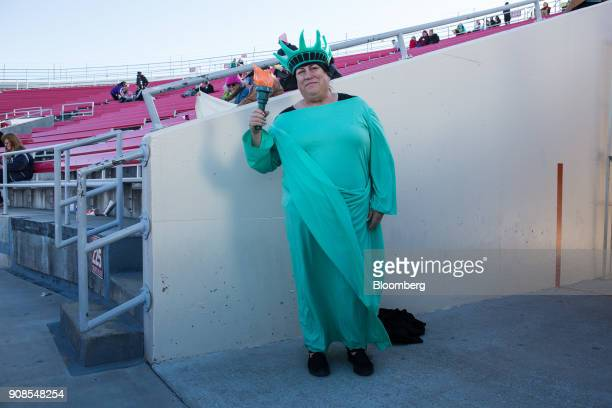 An attendee dressed in the likeness of Lady Liberty stands for a photograph in Sam Boyd Stadium during the Women's March OneYear Anniversary Power To...