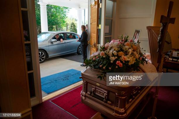 An attendee drives past during a viewing for Mrs. Barbara Lipscomb at the Fellows, Helfenbein & Newnam Funeral Home in Centreville, Maryland, on May...