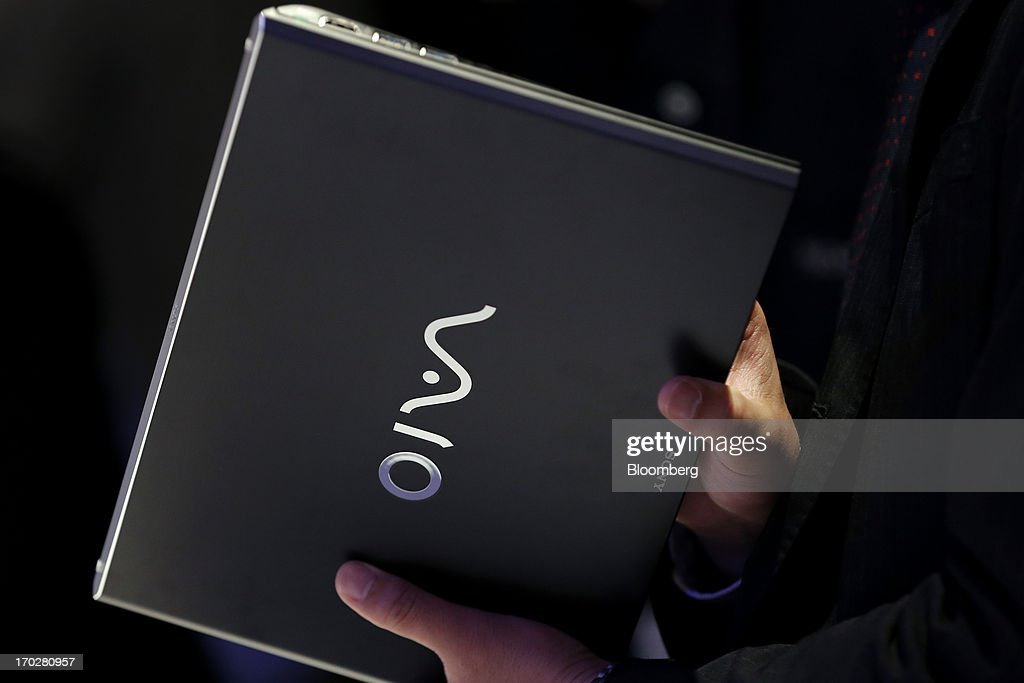 An attendee examines a Sony Corp. Vaio Pro Ultrabook laptop computer during a product launch in Tokyo, Japan, on Monday, June 10, 2013. Sony Corp. is Japan's biggest consumer-electronics exporter. Photographer: Kiyoshi Ota/Bloomberg via Getty Images