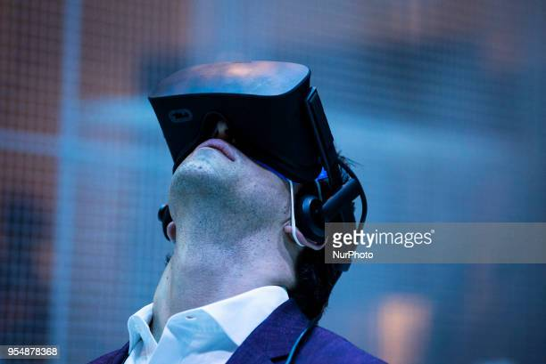 An attendee experiences Intel's virtual realty game at VRLA Virtual Reality Los Angeles expo in Los Angeles California on May 4 2018 VRLA is the...