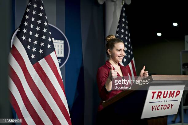 An attendee has her photograph taken at a podium during the Conservative Political Action Conference in National Harbor Maryland US on Friday March 1...